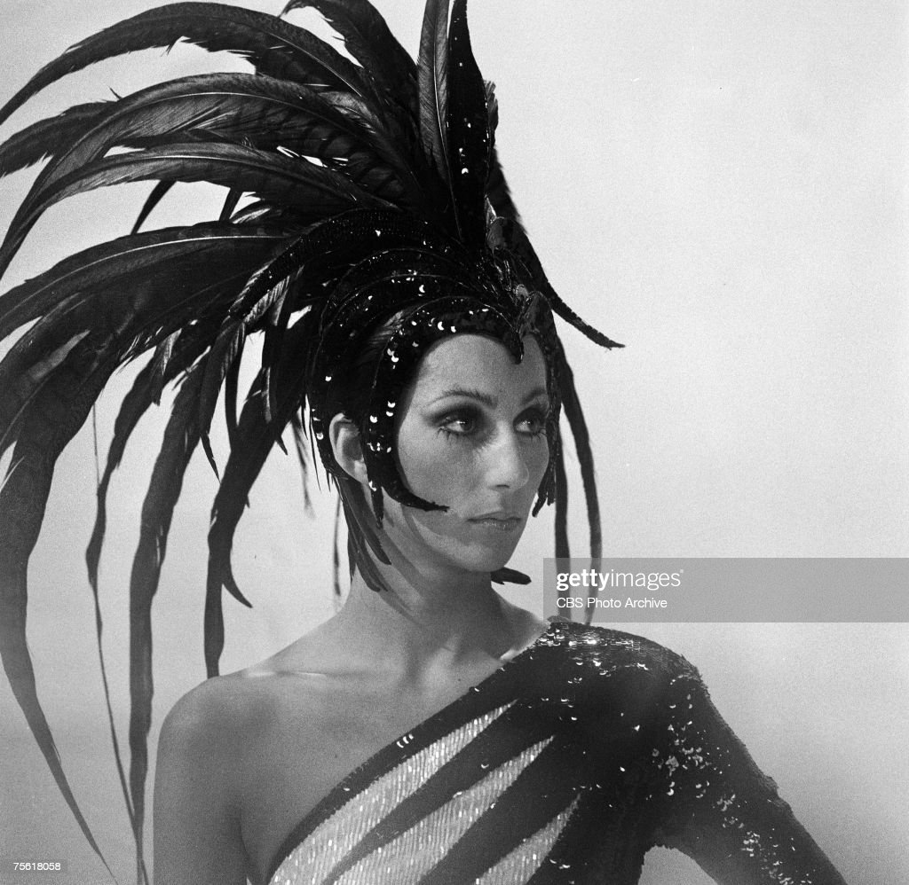 Portrait of American singer and entertainer Cher (born Cherilyn Sarkisian LaPiere) in a large, feathered headdress on an episode of 'The Sonny and Cher Comedy Hour,' January 18, 1973.