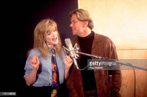 Portrait of American singer Peter Cetera and singer/actress Crystal Bernard pose together at the River North Recording studio Chicago Illinois April...