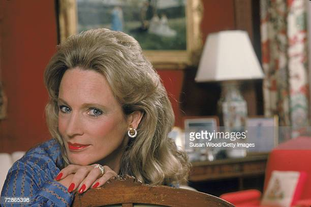 Portrait of American socialite Charlotte Ford as he rests her hands and chin on the back of a wooden chair May 1983