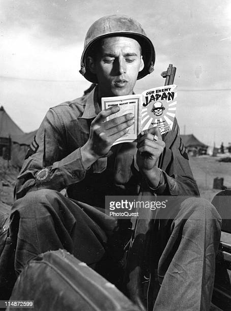 Portrait of American soldier Corporal Joseph Melosh as he reads 'Our Enemy Japan' shortly before is redeployment to the Pacific Theater of War 1945...