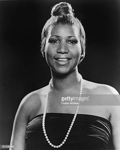 Portrait of American soul singer Aretha Franklin as she wears a strapless dress and pearl necklace and has her hair in a bun 1977