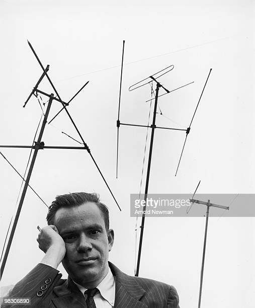 Portrait of American television critic and journalist Jack Gould against a backdrop of antennas July 10 1951