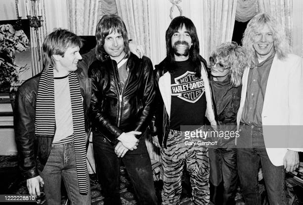 Portrait of American television personalities and MTV VJs Alan Hunter and Nina Blackwood as they pose with members of the fictional Heavy Metal band...