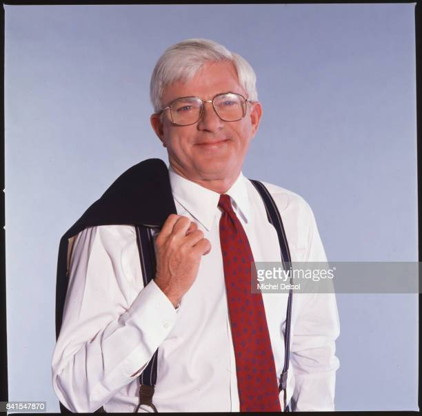 Portrait of American television personality Phil Donahue as he poses with his jacket over his shoulder New York New York May 19 1992 This photo was...
