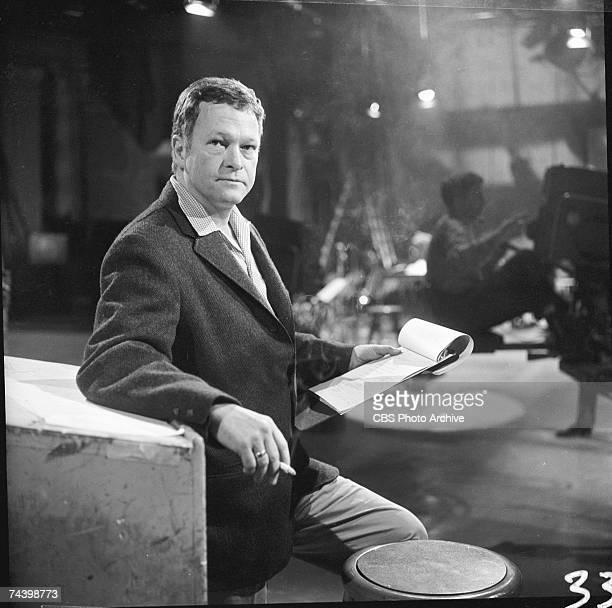 Portrait of American television producer Robert Herridge host and creator of Robert Herridge Theater stands in the studio during rehersals with his...