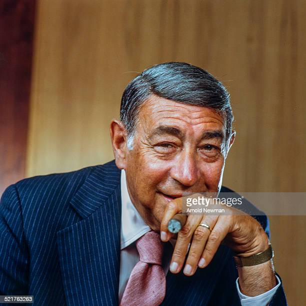 Portrait of American television sports journalist Howard Cosell as he poses with a cigar in his hand West Hampton New York July 16 1983