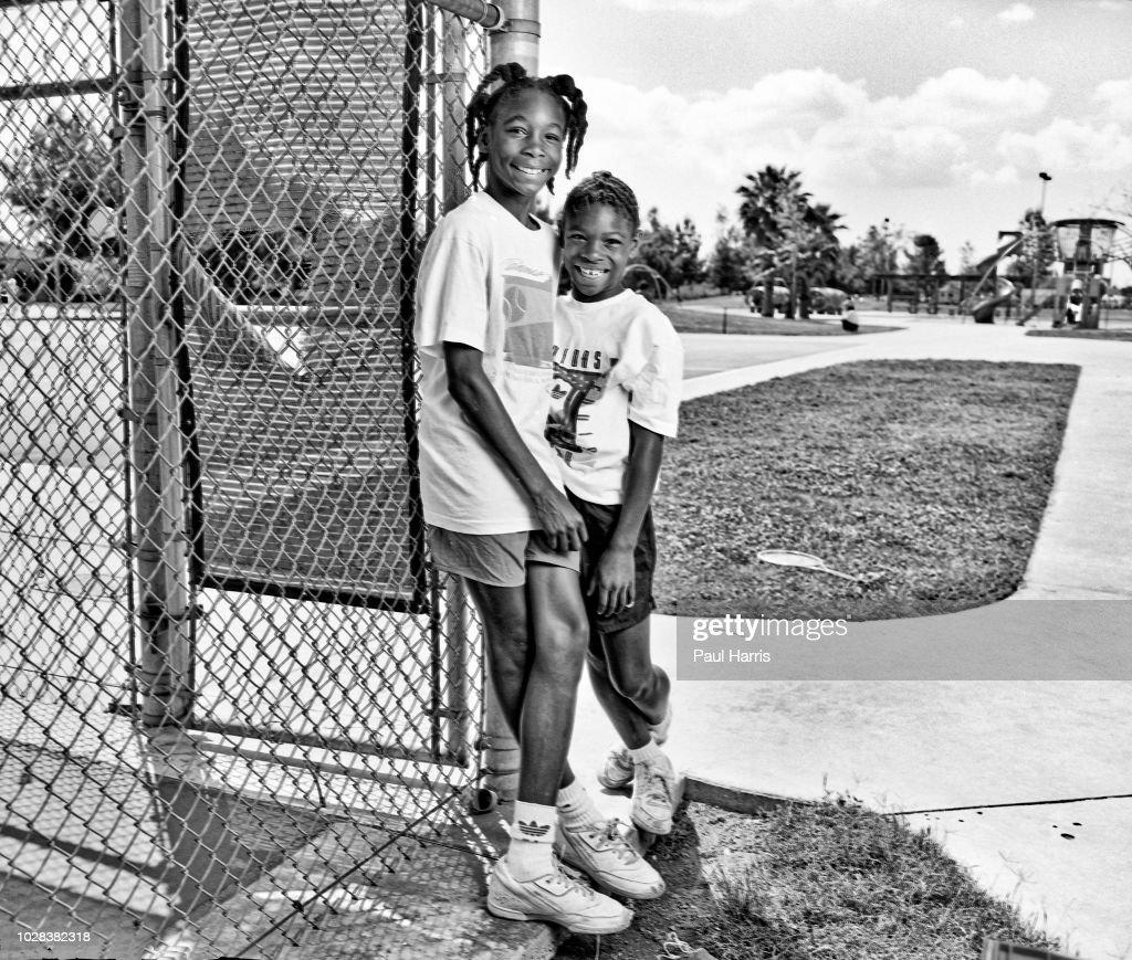 Venus & Serena Williams On Compton Tennis Court : News Photo
