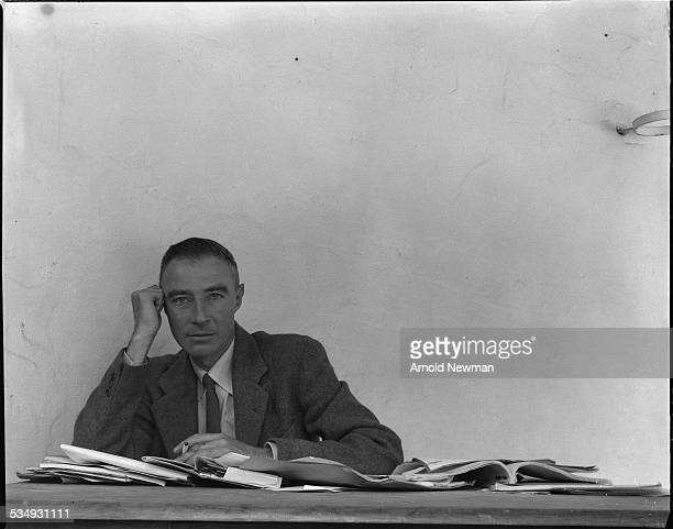 Portrait of American theoretical physicist Dr J Robert Oppenheimer as he sits at a table covered in papers Berkeley California June 6 1948...