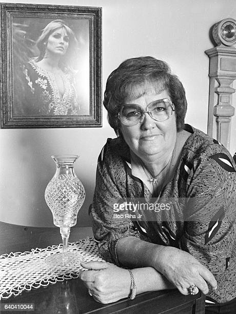 Portrait of American victim's rights activist Doris Tate as she poses in her home Los Angeles California October 03 1984 On the wall behind her is a...