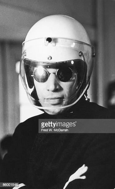 Portrait of American video and performance artist curator and author Willoughby Sharp as he poses arms crossed with a helmet on his head New York New...