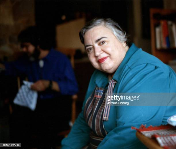 Portrait of American visual art and photography historian critic and professor Estelle Jussim as she sits in an armchair Massachusetts early 1990s
