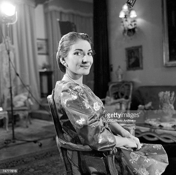 Portrait of American-born Greek opera singer Maria Callas sits in a chair during the filming of an episode of 'Small World,' December 1958. The...