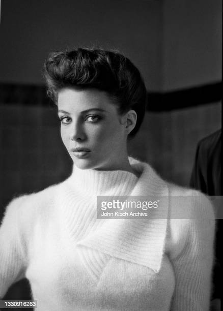 Portrait of American-British actress and model Kelly LeBrock in a white sweater, Eugenie Les Bains, Landes, France, 1980.