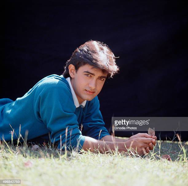 1988 Portrait of Amir Khan lying on grass
