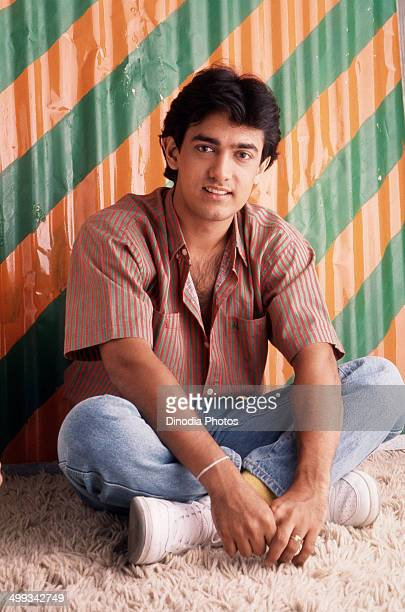 1988 Portrait of Amir Khan sitting on rug