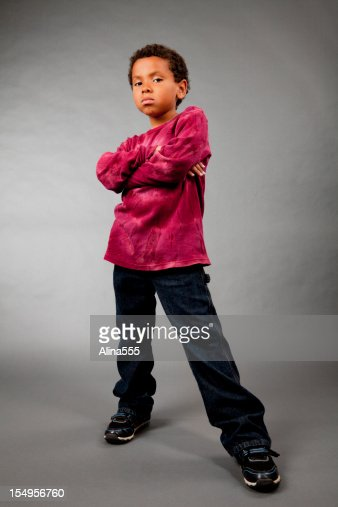 portrait of an 8year old mixed race boy on gray stock