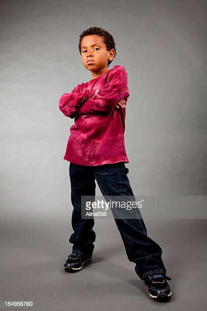 Portrait of an 8-year old mixed race boy on gray