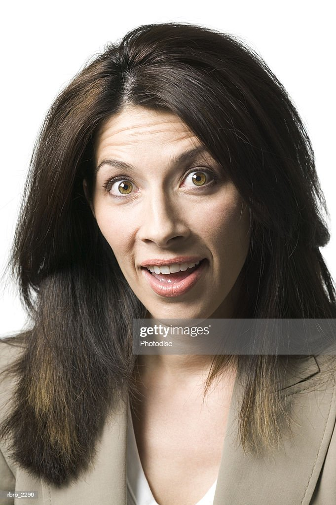 portrait of an adult brunette woman as she flashes a surprised expression : Foto de stock