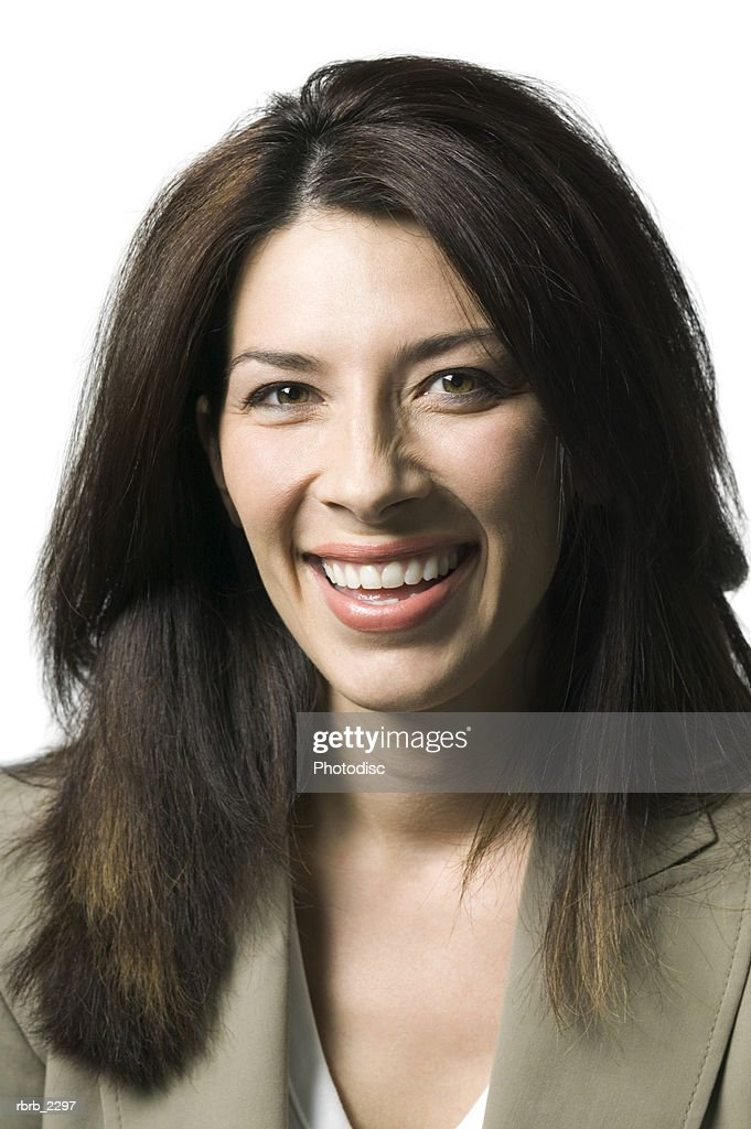 portrait of an adult brunette woman as she smiles brightly at the camera : Foto de stock