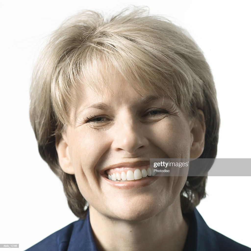 portrait of an adult caucasian blonde woman as she smiles happily : Stockfoto