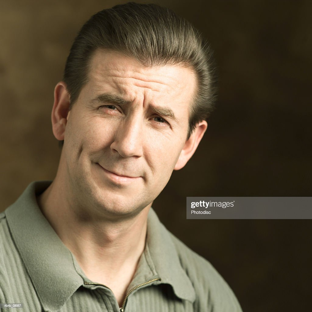 portrait of an adult caucasian man as he grimaces into the camera : Stockfoto