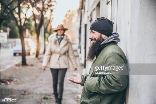 Portrait of an Adult Homeless Man on City Street