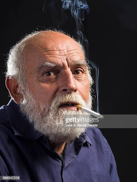 Portrait of an adult man with a cigarette in the mouth.