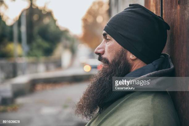 Portrait of an Adult Man with Long Beard Standing on City Street