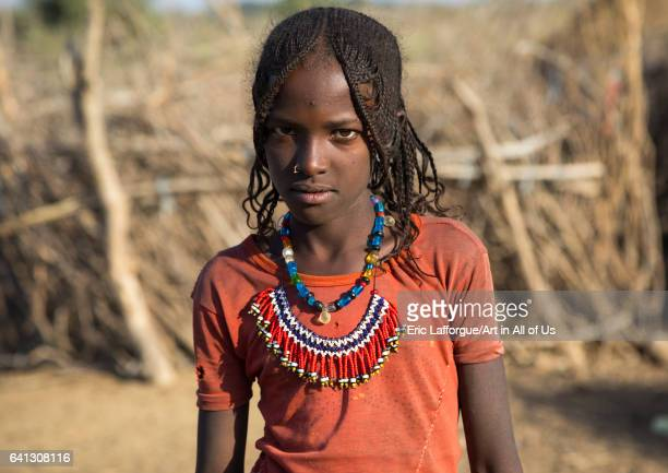Portrait of an Afar tribe girl with braided hair and beaded necklace on January 21 2017 in Chifra Ethiopia