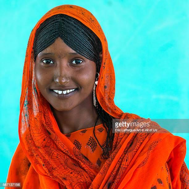 Portrait of an afar tribe girl with braided hair and sharpened teeth afar region semera Ethiopia on February 29 2016 in Semera Ethiopia