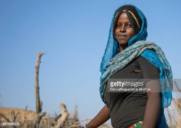 Portrait of an Afar tribe woman with braided hair on January 21 2017 in Chifra Ethiopia