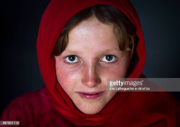 Portrait of an afghan girl with pale skin wearing red clothes badakhshan province khandood Afghanistan on August 13 2016 in Khandood Afghanistan