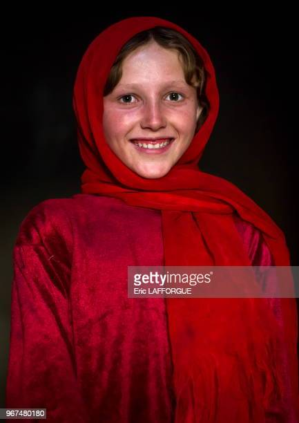Portrait of an afghan girl with pale skin wearing red clothes Badakhshan province Khandood Afghanistan