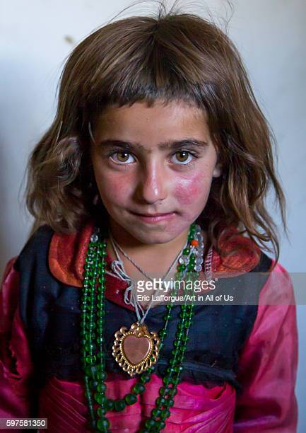 Portrait of an afghan girl with red cheecks badakhshan province khandood Afghanistan on August 9 2016 in Khandood Afghanistan