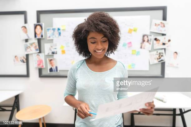 Portrait of an African American business woman brainstorming at a creative office