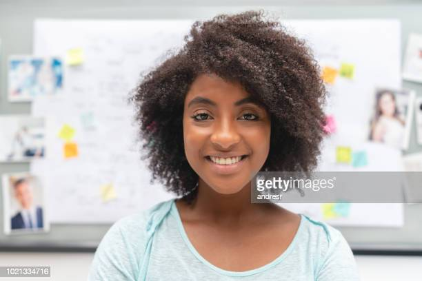 portrait of an african american business woman brainstorming at a creative office - business plan stock pictures, royalty-free photos & images