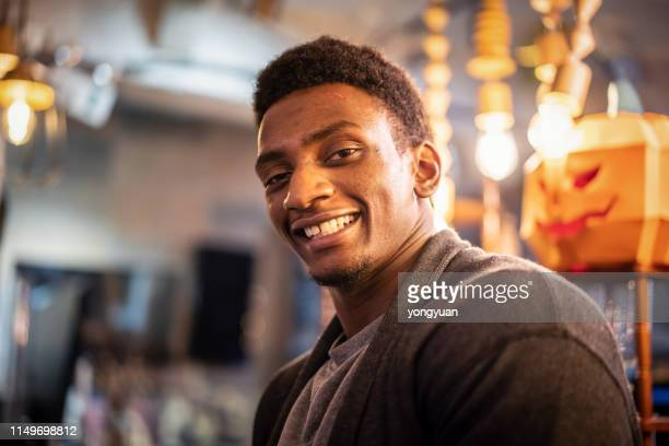 Portrait of an African man in a cafe