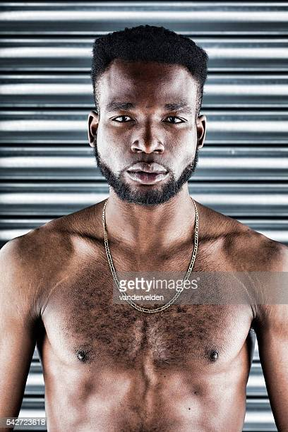 portrait of an african man - hairy man chest stock photos and pictures