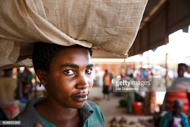 Portrait of an African market woman carrying a bag on her head on August 11, 2016 in Kigali, Rwanda.