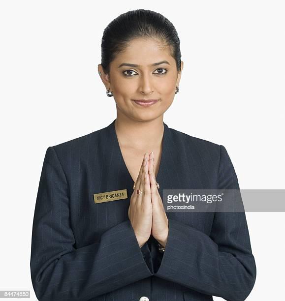 Portrait of an air hostess welcoming