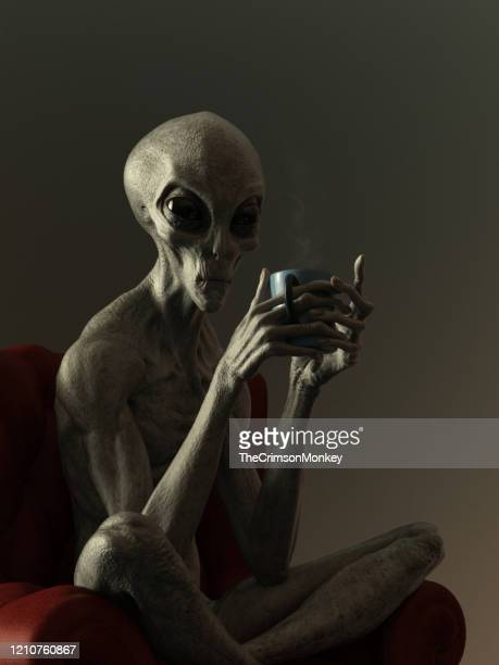 portrait of an alien drinking hot beverage - alien stock pictures, royalty-free photos & images