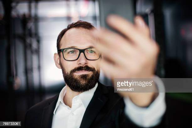 Portrait of an ambitious businessman, taking a selfie