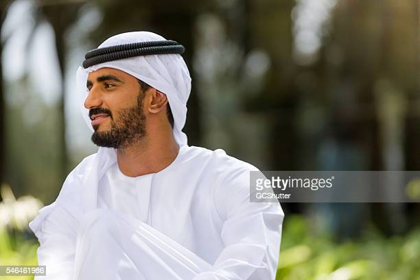 portrait of an arab man in a park - national landmark stock pictures, royalty-free photos & images