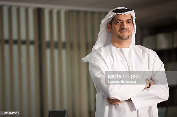 portrait of an arab man in an office. - kaffiyeh stock pictures, royalty-free photos & images