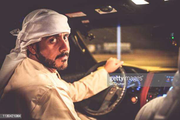 Portrait of an Arab Man Seated on the Driver Seat of a SUV