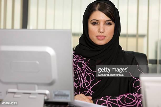 Portrait of an arab woman in an office.