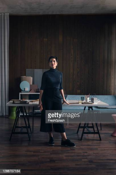 portrait of an architect at her modern spacious studio - chief executive officer stock pictures, royalty-free photos & images
