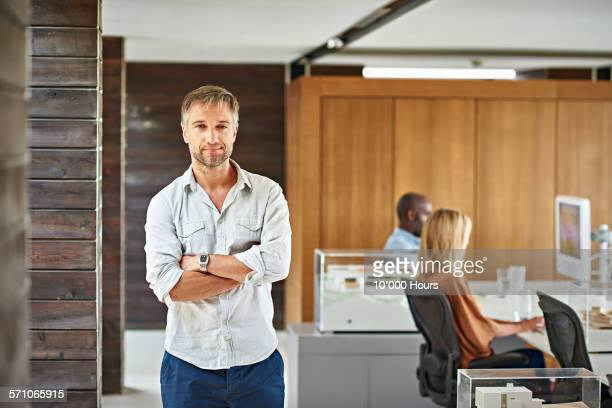 portrait of an architect in a modern office - 35 year old man stock pictures, royalty-free photos & images
