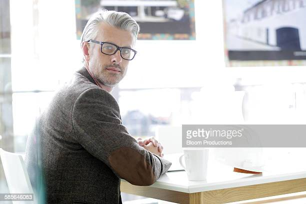 portrait of an architect in a modern office - looking over shoulder stock pictures, royalty-free photos & images