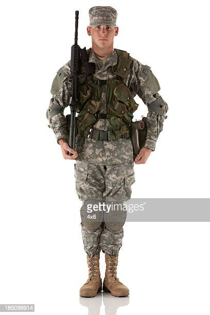 portrait of an army man with a rifle - army stock pictures, royalty-free photos & images